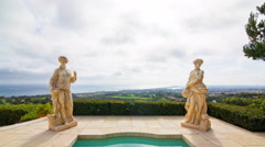 Time Lapse of Statues by Jacuzzi at Expensive Mansion in Newport Beach Tilt Down Stock Footage