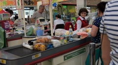 People at the cashdesk in Auchan supermarket Stock Footage
