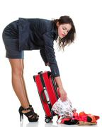 Full length young business woman to late red travel bagd Stock Photos
