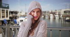 Portrait of Woman smiling at camera. Young lady in her 20s wearing striped Stock Footage