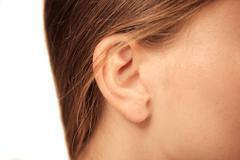 Close up on female ear Stock Photos