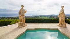 Time Lapse of Statues by Jacuzzi at Expensive Mansion in Newport Beach -Pan R- Stock Footage