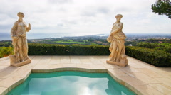 Time Lapse of Statues by Jacuzzi at Expensive Mansion in Newport Beach -Pan L- Stock Footage