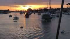 Sunset in the distance while motoring through moorings in Newport Harbor Cali Stock Footage