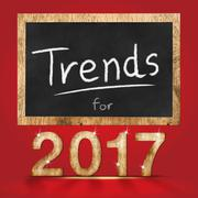 Trend for 2017 year  wood texture number with blackboard at red studio backdr Stock Photos