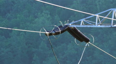 Electrical insulators on power transmission line, 4K Stock Footage