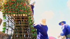Workers Construct High Tower Flowerbed with Flowerpots Stock Footage