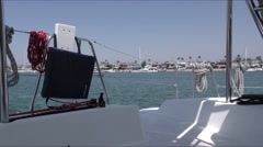 View of back of catamaran looking from port aft area through ropes and life l Stock Footage