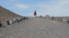 Lanzarote- solitary man climbs the volcano through a path Stock Footage