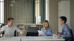 Co-working people are discussing business agreement in office Stock Footage