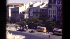 1948: Vintage automobiles circling historic landmark near statues monument buses Stock Footage