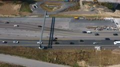 Aerial view of large bridge construction site Stock Footage