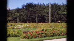 1948: A beautiful garden is seen with a lamp post and trees around.PORTUGAL Stock Footage