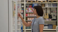 Woman choosing fridge in white goods store Stock Footage