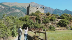Châtillon, Aosta valley, Italy. Tourists taking a picture of  Castle of Ussel Stock Footage