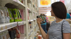 Woman buying cereals in the grocery Stock Footage