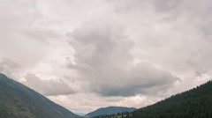 Clouds over the mountains. Grigoriev gorge, Issyk-Kul, Kyrgyzstan. Time Lapse Stock Footage