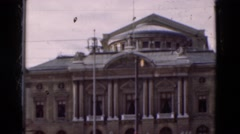 1948: Peacock bird free roaming zoo grounds showing plumage near food Stock Footage
