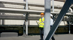 4K Engineers carrying out an inspection at urban industrial site Stock Footage