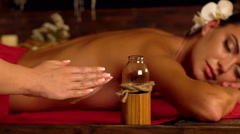 Close-up of hands masseuse with massage oil in spa salon. Stock Footage