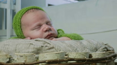 A baby in a green cap asleep Stock Footage