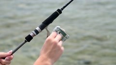 Spinning Reel. Sea fishing. A man fishing on the coast. Stock Footage