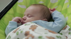 A baby fast asleep in a cradle Stock Footage