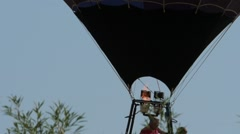 Slow motion close hot air balloon landing Stock Footage