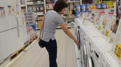 Woman choosing washer in the store Stock Footage