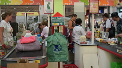 Customers at the cash-desk in Auchan hypermarket Stock Footage
