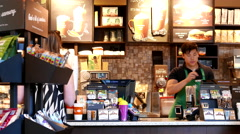 One side of people buying coffee inside Starbucks store with 4k resolution. Stock Footage
