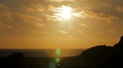 Sunset by the sea , the sun starts to fall down Stock Footage