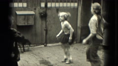 1953: Girls are seen skipping rope and having fun.MILWAUKEE, WISCONSIN Stock Footage