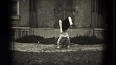 1953: A child is seen doing a handstand.MILWAUKEE, WISCONSIN Stock Footage