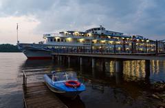 Cruise ship Alexandre Benois at river quay in evening, Russia Stock Photos