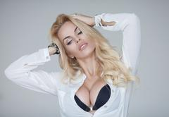 Sexy blond woman with big boobs Stock Photos