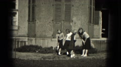1953: older cheerleader teaching new recruits the ropes outside..MILWAUKEE, Stock Footage