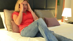 Mid adult beautiful woman with blonde hair with strong headache depressed Stock Footage