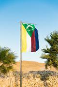 National flag of Comoros on flagpole Stock Photos