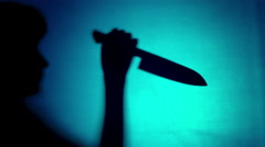 4k Halloween Shot of Shadow of a man Holding Knife Stock Footage