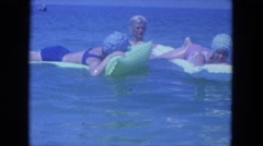 1964: women swimming of the water mattresses.CLEARWATER, FLORIDA Stock Footage