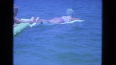 1964: Girls are seen in a swimming pool trying to have a nice time.CLEARWATER, Stock Footage