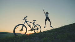Happy guy jum and jump on the sunset background Stock Footage