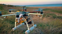Custom hexacopter drone flies in the sky. Slow motion. Stock Footage