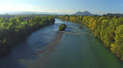 AERIAL: Beautiful big river with powerful current of water surrounded by forest Stock Footage