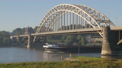 River transport boat under Waal Bridge,Nijmegen,Netherlands Stock Footage