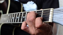 Guitarist strumming guitar Stock Footage