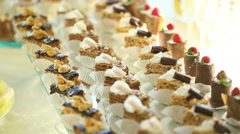 Wedding candy bar.Candy bar with cookies and colorful candy on plate for Stock Footage