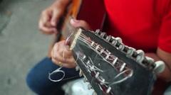 Woman Guitarist strumming Bandurria guitar Stock Footage