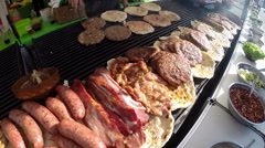 Various Delicious Meat on a Large Barbecue Hot Smoky Grill Stock Footage